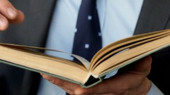 Businessman holding book and reading it, steadycam shot Stock Footage