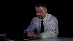 Emotions rage. A man sitting at his laptop in anger Stock Footage