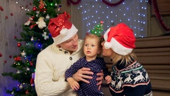 Family celebrate a Christmas and New Year. A little child glad. Confetti flying Stock Footage