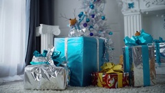 Christmas fir, holiday gifts, white fir in the room Stock Footage