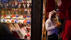 People shopping In Christmas Market, Vienna, slow motion Stock Footage