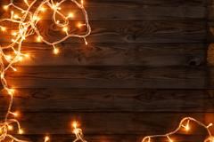 Garland on brown wooden background Stock Photos