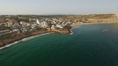 Aerial. Tourist village of Luz beach, with views of the sky over the sea. Stock Footage