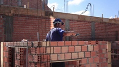 Worker building masonry house Stock Footage