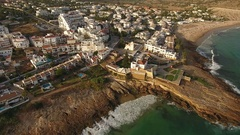 Aerial. Flying over the square and the church, the village of Luz. Stock Footage