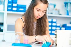 Student teen girl with experiment PEM proton exchange membrane reversible fuel- Stock Photos