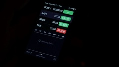Stock market checking values on a smartphone internet device Stock Footage