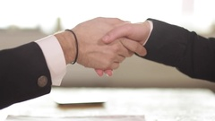 Businessman and businesswoman shaking hands in office Arkistovideo