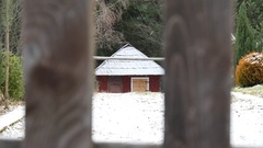 Cottage and windy snowy day slow motion Stock Footage