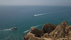 Aerial. Flight and video shooting over the bay with ships Ponta da Piedade. Stock Footage