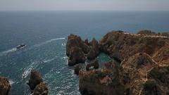 Aerial. Flight and video shooting over the Cape Ponta de Piedade. Stock Footage