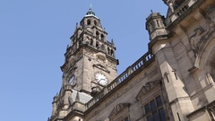 Town Hall Clock Tower and Shoppers in City Centre, Sheffield, South Yorkshire Stock Footage