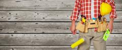 Builder handyman with paint roller. Stock Photos