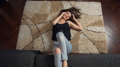 Attractive Girl Phone Talking Lying on Floor Carpet Stock Footage