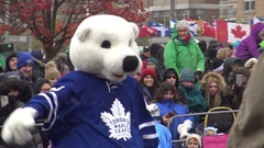 Maple Leaf Mascot at Santa Claus Parade Toronto 2016 Stock Footage