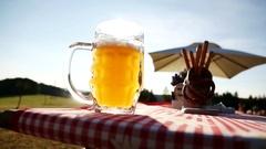 German weiss beer in summer in a beer garden Stock Footage