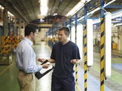 Men Talking in Automotive Plant Stock Photos
