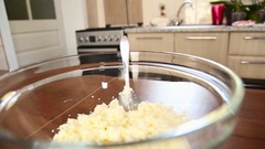 Cheese in a plate on the kitchen table Stock Footage