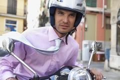 Businessman Riding Moped Stock Photos