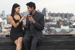 Couple Drinking Wine on Balcony, Soho, New York City, New York, USA Stock Photos