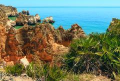 Summer Atlantic rocky coastline (Algarve, Portugal). Stock Photos