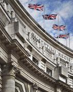 Top of the Admiralty Arch building with British Flags, London, England Stock Photos