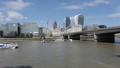 River Thames Cruise Boats & The City Skyline & London Bridge, London Stock Footage