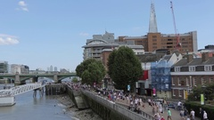 River Thames & The City Skyline from The Millennium Bridge, London Stock Footage