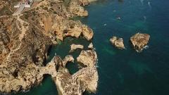 Aerial. Details Cape Ponta de Piedade and boats filmed from the sky. Stock Footage