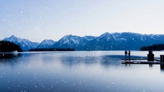 White christmas, peaceful winter lake,  couple on dock with snow effect Stock Footage