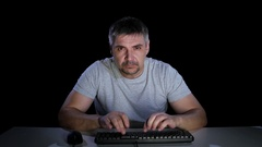 Guy furiously writing e mail to his boss Stock Footage
