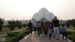 People walking  in front of the Lotus Temple (Baha'i Temple) in Delhi, India Stock Footage