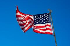 Star spangled banner with blue sky Stock Photos