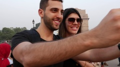 Couple taking a selfie in India Gate, New Delhi Stock Footage