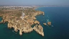 Aerial. Cape Lighthouse Ponta de Piedade, filmed from the sky. Lagos. Stock Footage