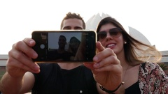 Couple taking a selfie in Lotus Temple (Baha'i Temple) in Delhi, India Stock Footage