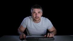 Man afraid of watching online movie. Emotions of fear. Studio Stock Footage