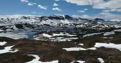 Frozen mountain lake in Norway Stock Footage
