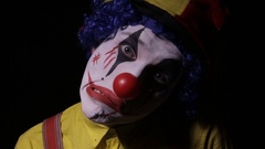 Evil, horror clown man looking into camera Stock Footage