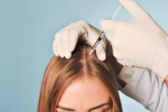 Woman is getting injection in head. Mesotherapy. Stock Photos
