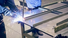 Unrecognizable welder welding at a industrial plant Stock Footage