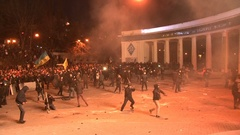 Kyiv. Maidan. Protesters throw stones and set fire to tyres on the barricade. Stock Footage
