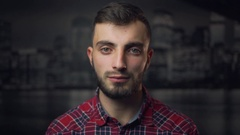 Serious Young Man Looking in Camera Stock Footage