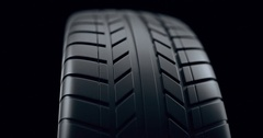 Close up on a car tire in motion, with deph of field effect. Seamless looping Stock Footage