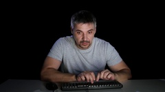 Man is worried from what he saw in the monitor Stock Footage