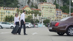Chauffer helping young woman with luggage, elite car service, transportation Stock Footage