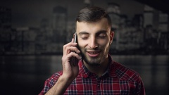 Young Attractive Lumbersexual Man Talking by Phone Stock Footage