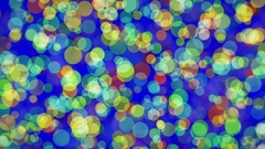 Flashing colored circles on blue Stock Footage