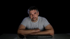 Man with indifference looking at a computer screen Stock Footage