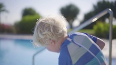 Closeup Shot Of Boy Playing With Water Gun On Poolside Stock Footage